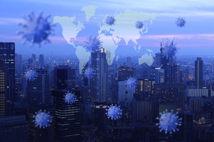 Images of coronavirus virions superimposed over a cityscape.