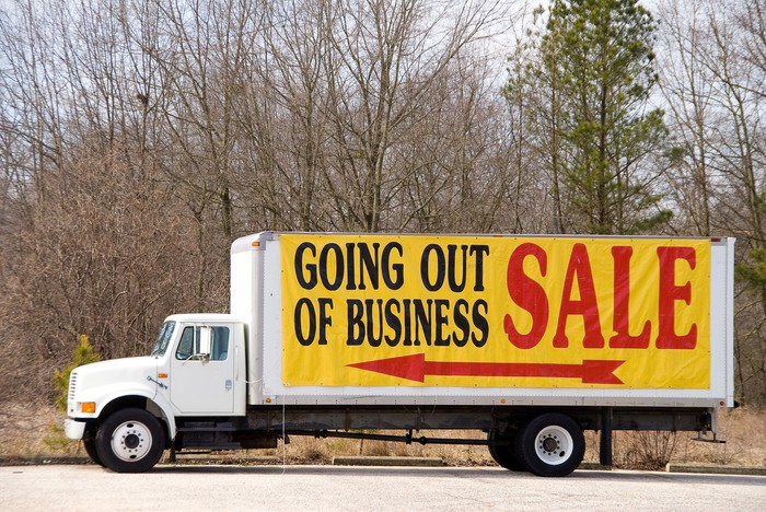 """""""Going out of business sale"""" sign on a truck."""