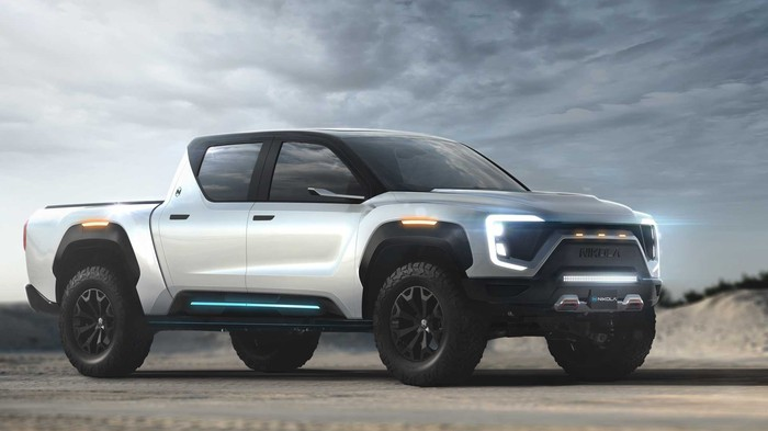 The Nikola Badger pickup truck concept vehicle is shown sitting on a roadway under cloudy skies