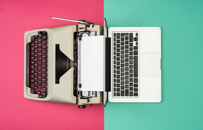 A Typewriter next to a laptop to signify the shift to the digital era.