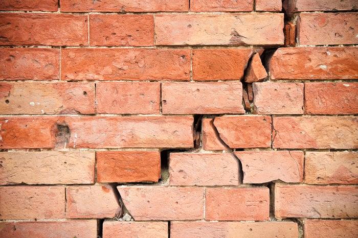 Brick wall with severe cracks.