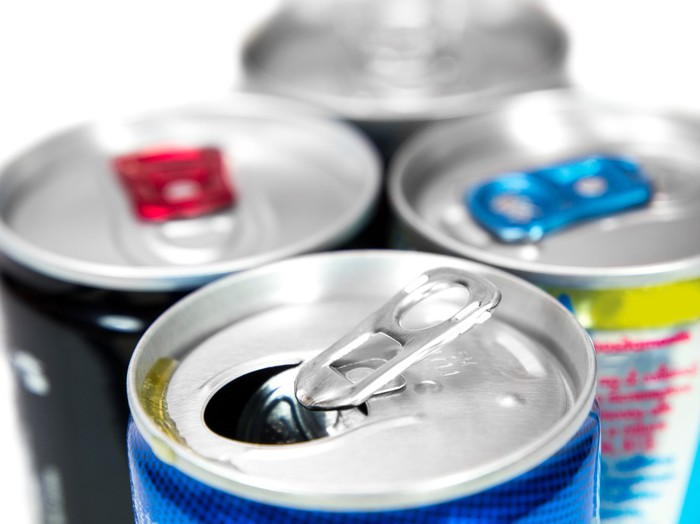 An up-close view of multiple energy drink cans.