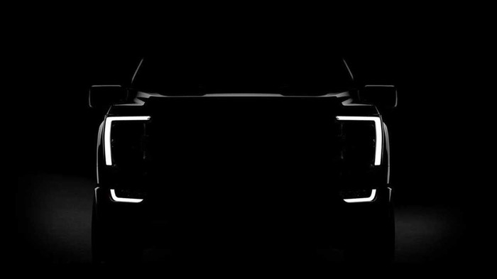 A darkened photo of the front end of a pickup truck.