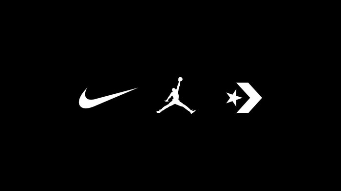 A Nike logo next to a Michael Jordan logo and a star symbol f black lives matter movement  all in white against black background.