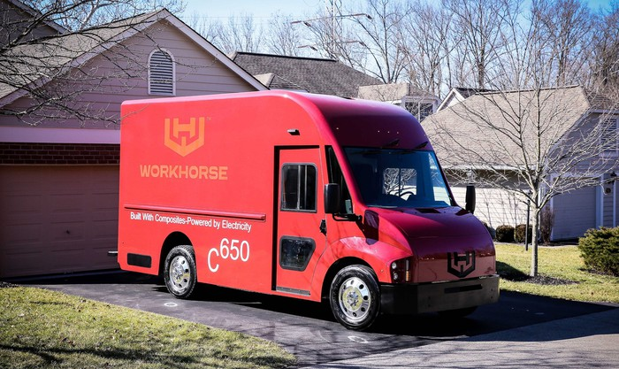 A red Workhorse C-650, an electric package-delivery van.