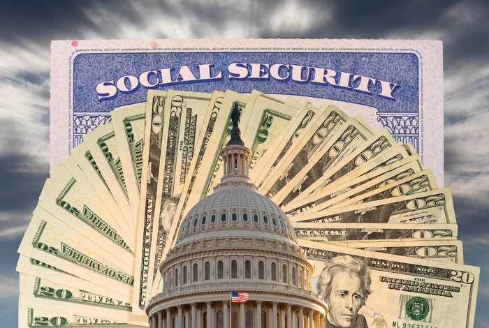 Social Security card above $20 bills fanned out with the U.S. Capitol building in the foreground