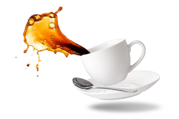 Coffee spilling from a cup.