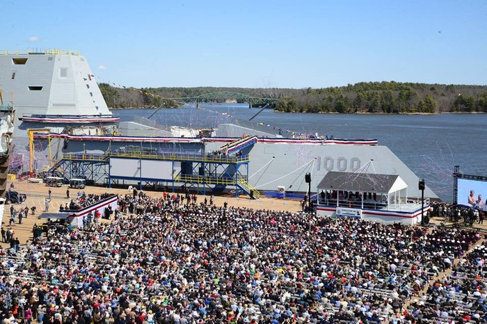 A destroyer is commissioned at Bath Iron Works.