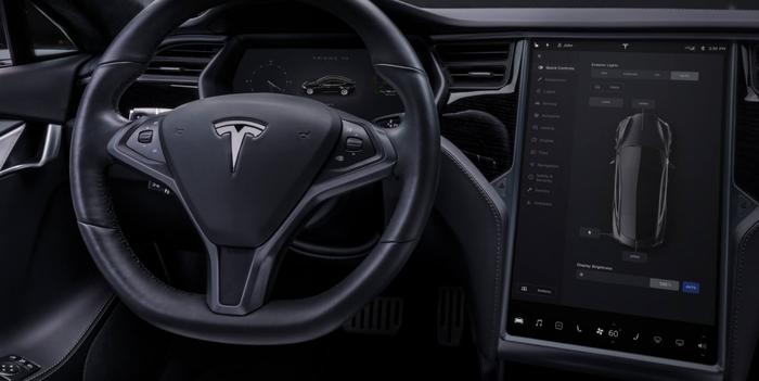 The steering wheel and touchscreen display in the Model S.