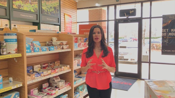 Woman in GNC store