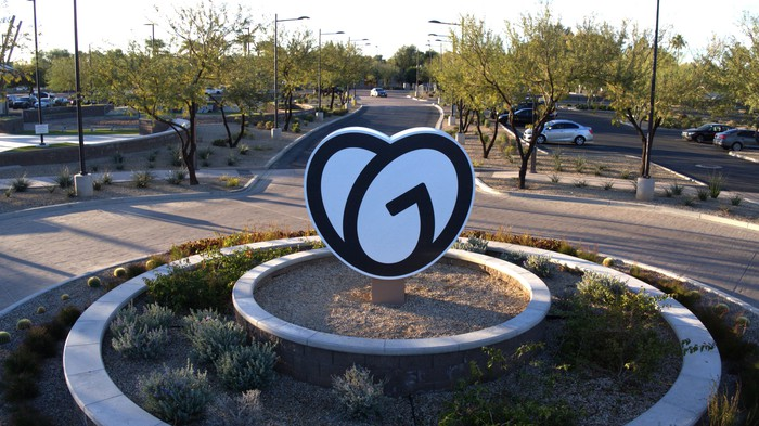 GoDaddy logo sign in the middle of a cul de sac front of Tempe office