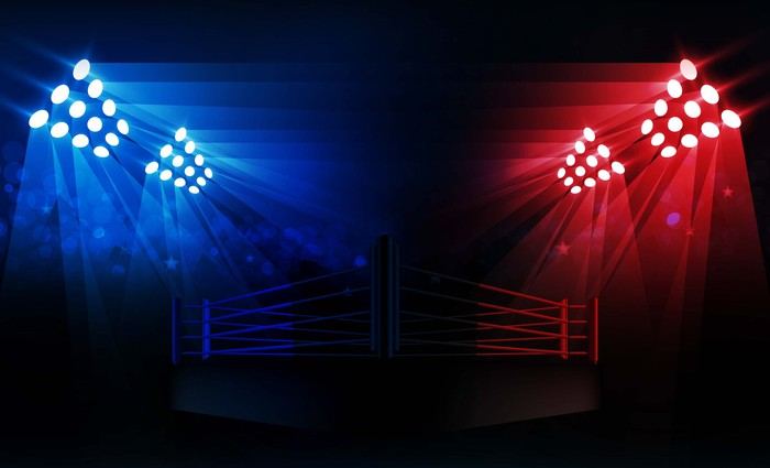 A wrestling ring lit with blue and red lights.