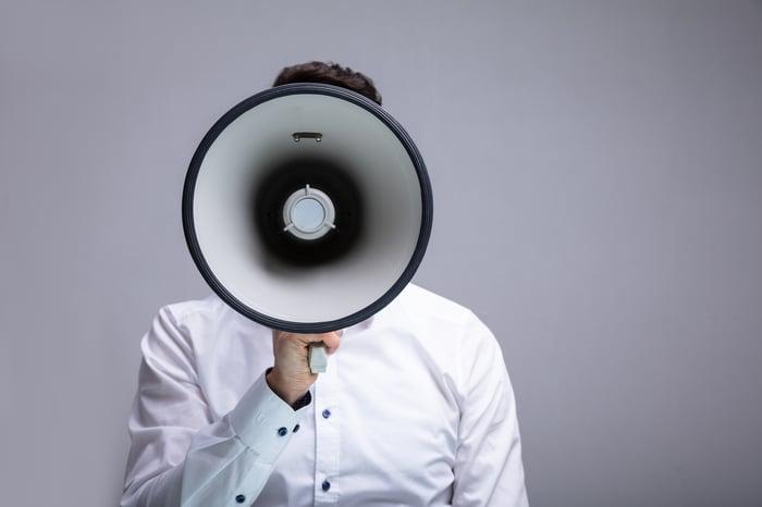 A man speaks through a megaphone.