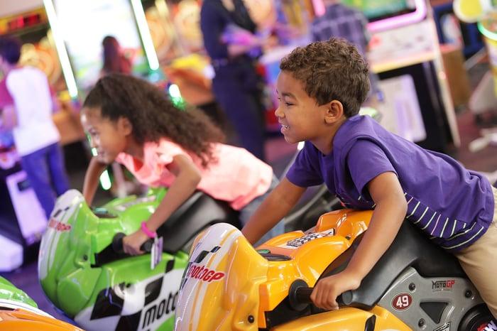 Kids playing on arcade rides