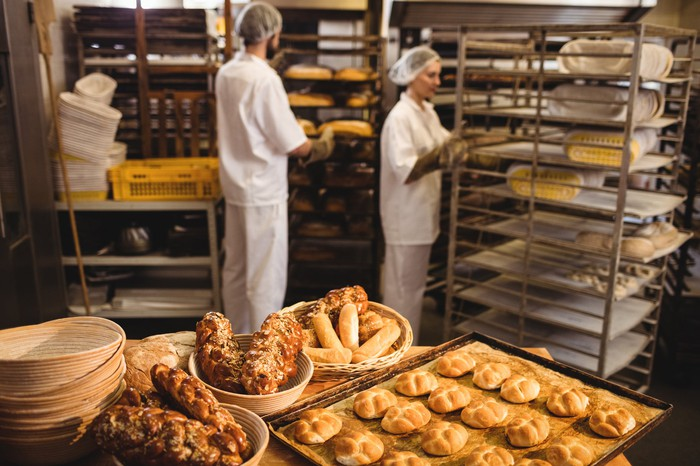 Man and woman working in bakery