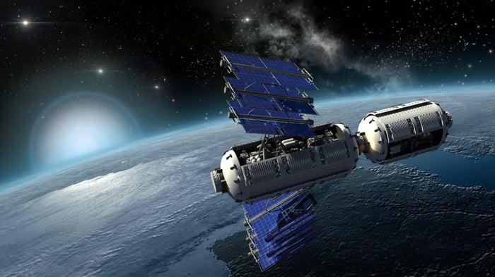 Spy satellite in orbit over Earth