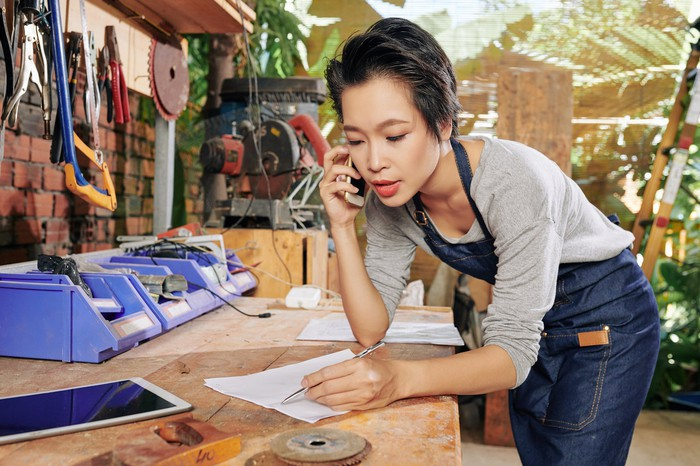 Woman on the phone in her small business.