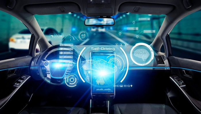 driverless car interior with autonomous controls lit up