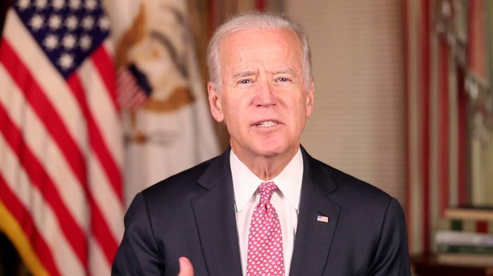 Joe Biden with an American flag in the background
