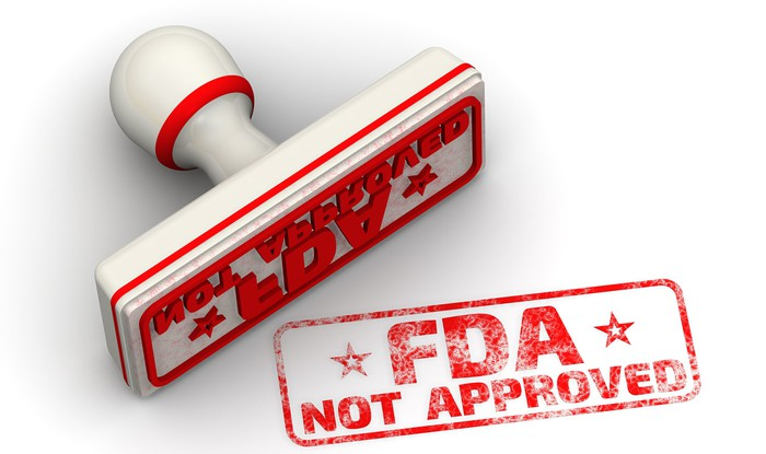 A rubber stamp reading FDA Not Approved
