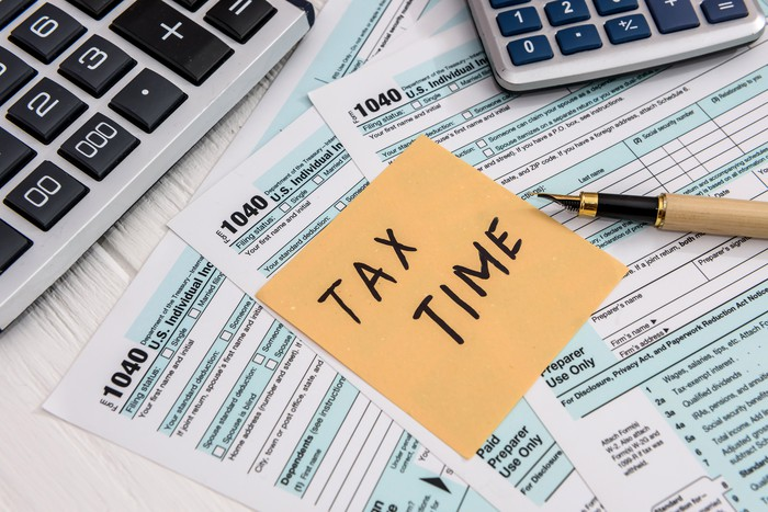 Tax forms and calculators with note that says Tax Time