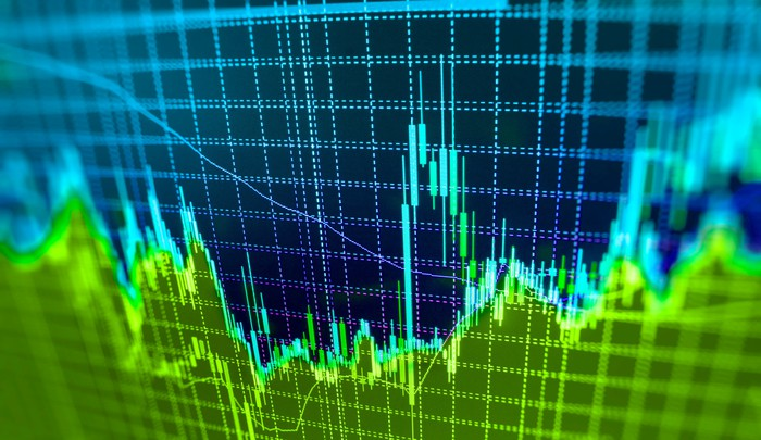 Blue and green stock chart going up and down