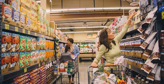 Two women shop in a Grocery Outlet location.