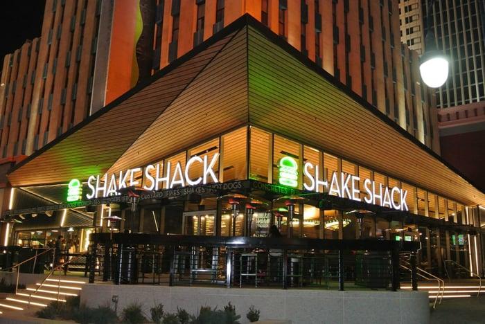 Shake Shack restaurant exterior at night.