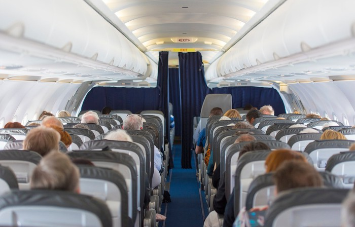 An airline cabin full of passengers