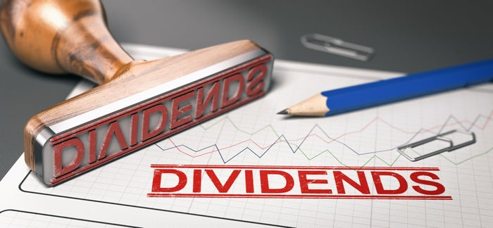 """dividends"" stamped on a paper chart"