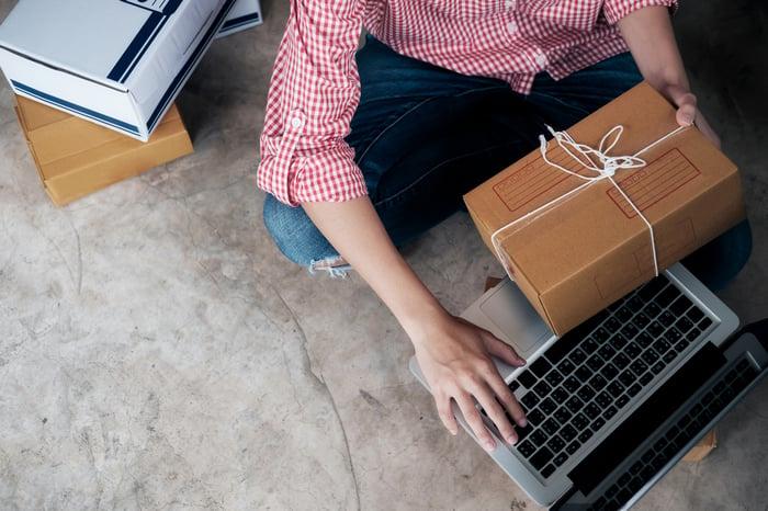 An online merchant prepares a shipment.
