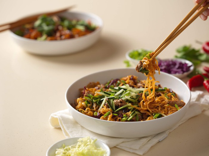 Chopsticks hold spicy Korean beef noodles from Noodles & Company.