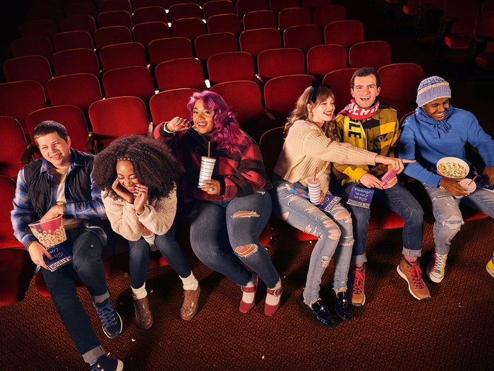 Teens at a movie theater wearing American Eagle Outfitters clothing.