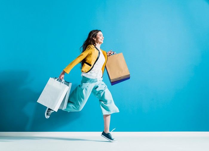 Woman running with shopping bags.