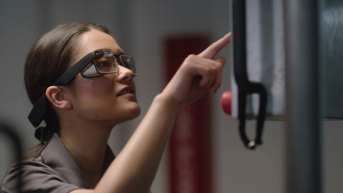 A woman wearing the second enterprise-oriented version of Google Glass.