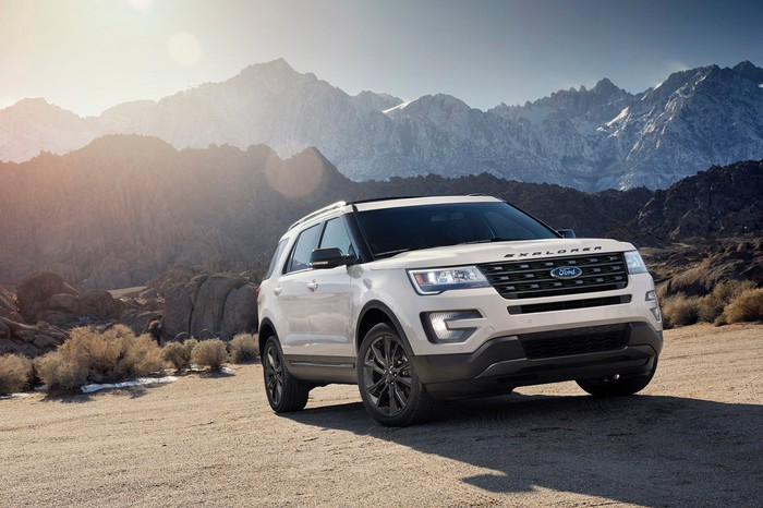 A Ford Explorer with mountains in the distance.