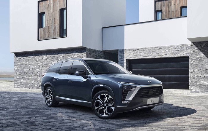 A blue NIO ES8, a large upscale electric crossover SUV.