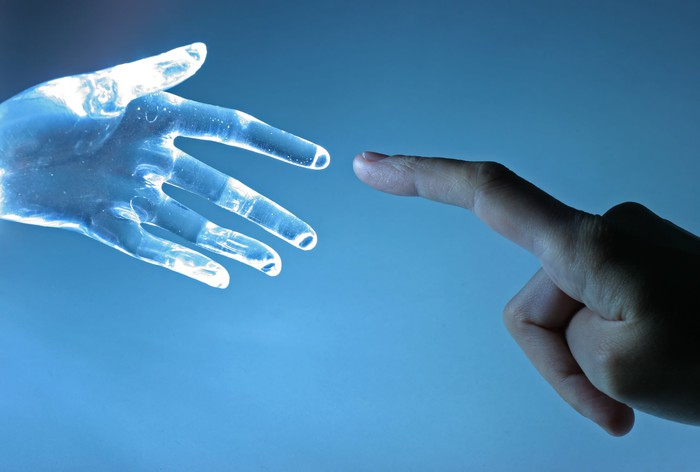 Human hand touching index finger with a virtual hand's index finger