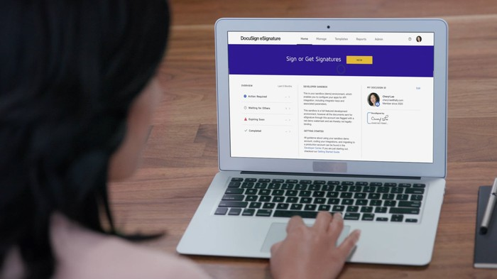 Woman using DocuSign eSignature platform on a laptop