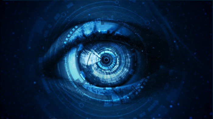 closeup of an eye in blue animation with electronic graphics  superimposed on it.