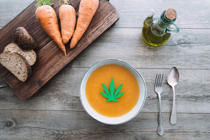 Carrot soup with marijuana oil and leaf inside.