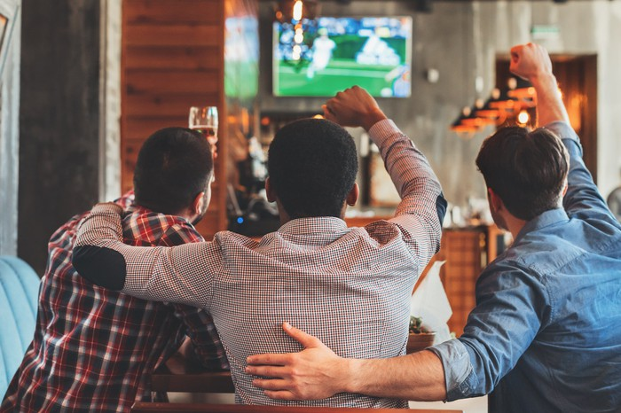 Men watching live sports on TV.