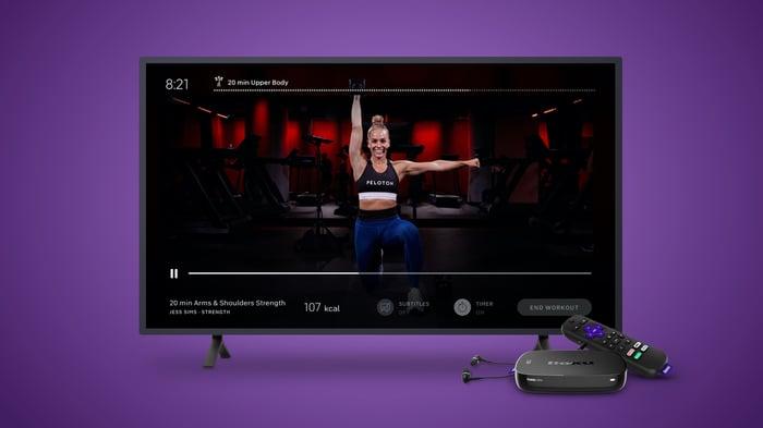 A Roku TV playing a Peloton workout.