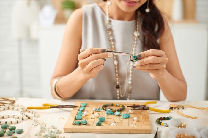 An artisan makes handmade jewelry.