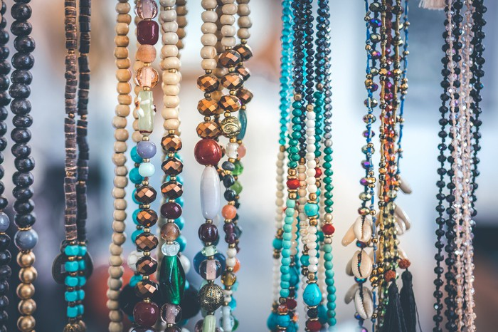 Handmade necklaces on display.