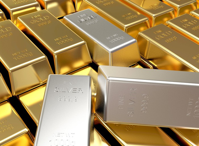 Stacks of gold and silver bars.