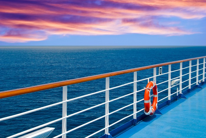 view from cruise ship deck with life preserver on rail