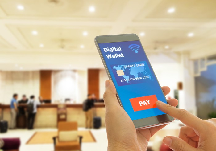 "User tapping on ""pay"" on digital wallet on mobile phone"