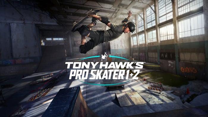Tony Hawk doing a skateboard trick and the logo for 'Tony Hawk's Pro Skater 1+2.'