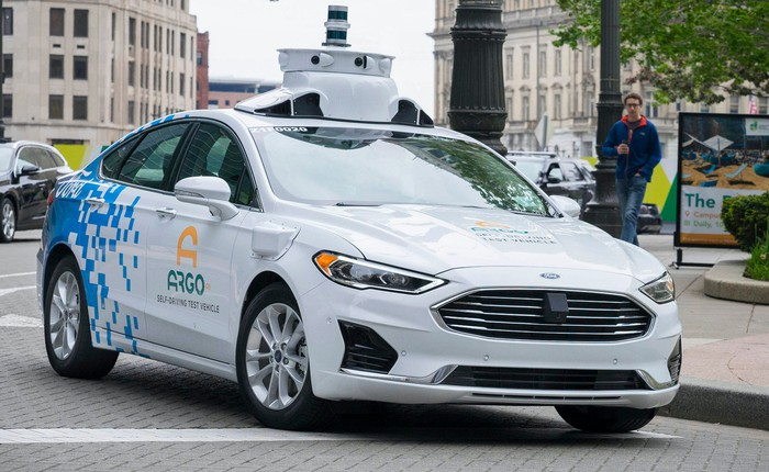 A prototype self-driving sedan developed by Ford and Argo AI, with Velodyne sensors visible on its roof.